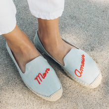 Load image into Gallery viewer, soludos chambray slippers with red stitching spelling mon amour