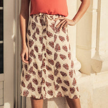 Load image into Gallery viewer, Woman in floral midi skirt