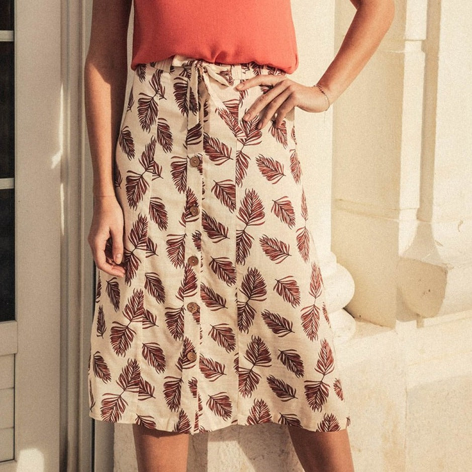 Woman in floral midi skirt