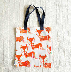 Twill bags, cotton, day out in the sun, Play, park, outing, kid's carry bag, machine wash block prints, carry bag, summer, beach, ferry, Toya's, mapayah, fun prints, Scandanavian Design, playful patterns, hand finished, kids gifting, kids, bespoke patterns, easy to clean, fox print,