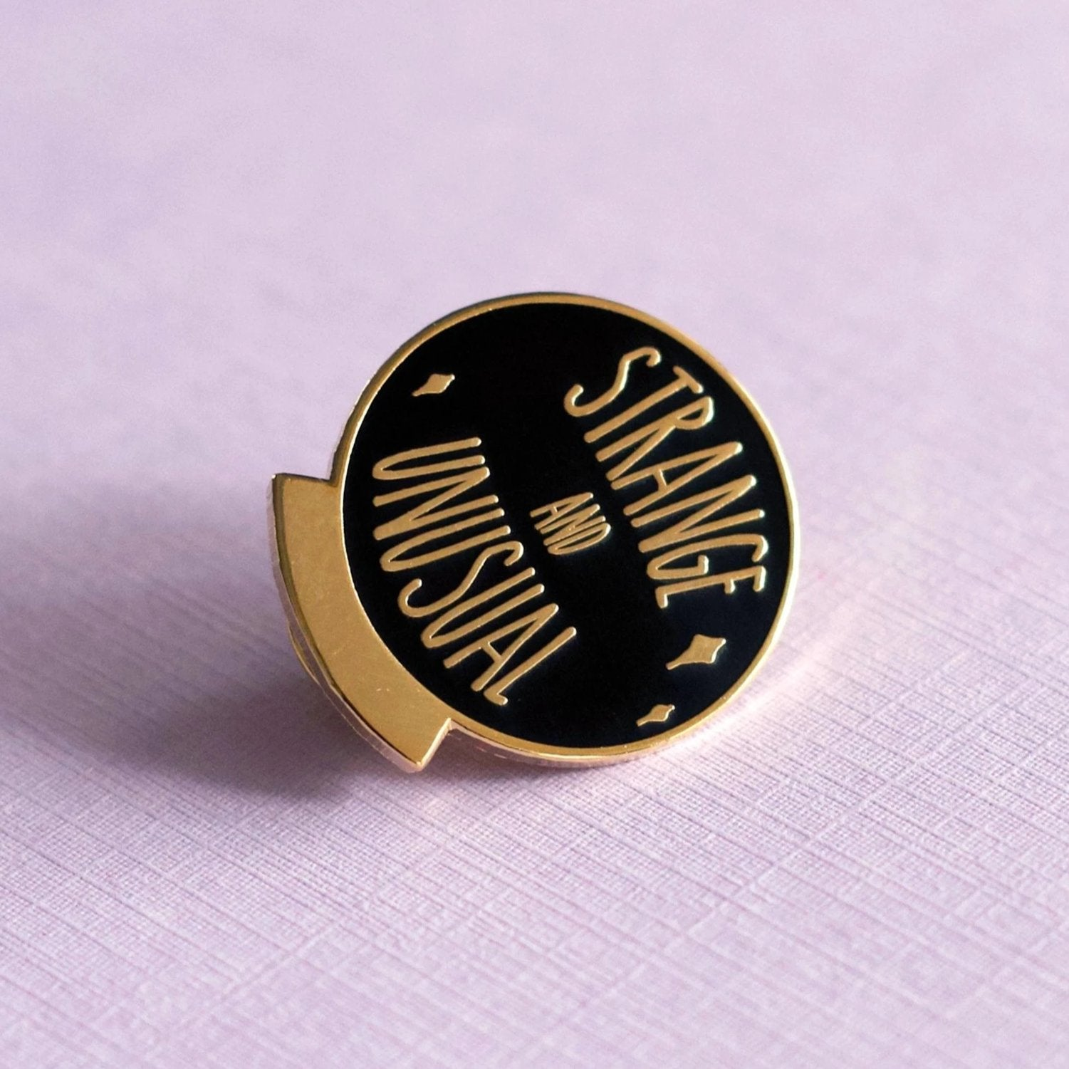 Strange and Unusual Enamel Pin