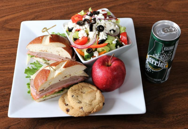 Meat Trio, Greek Salad, Apple, 2 Chocolate Chip Cookies, Perrier