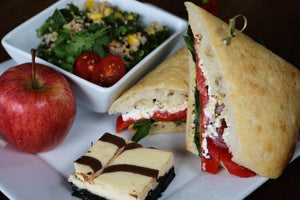 Roasted Red Pepper Deli Bun, Quinoa Salad, Apple, Brownie Cheesecake Square, Perrier