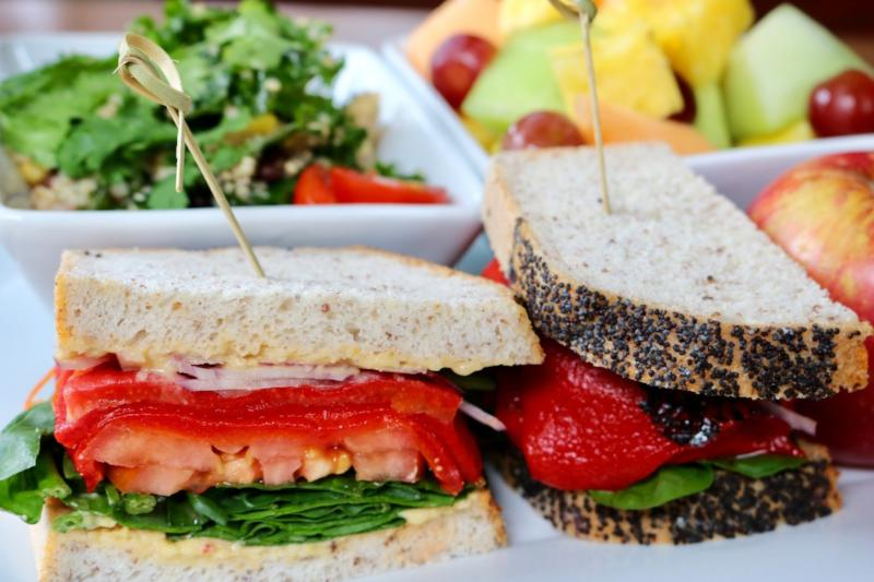 Vegan-Friendly Sandwich, Quinoa Salad, Mixed Fruit Salad, Perrier