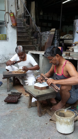 Kolka artisans at work - wood carving