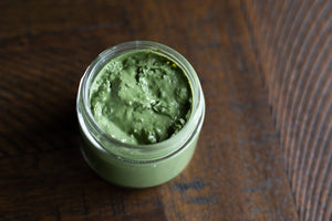 lavender matcha mask open, showing mask texture, on a tabletop
