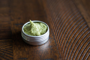 uncapped metal tin of green matcha mint sugar scrub in 1/2 oz size