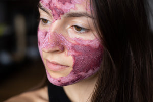woman wearing pink hibiscus face mask