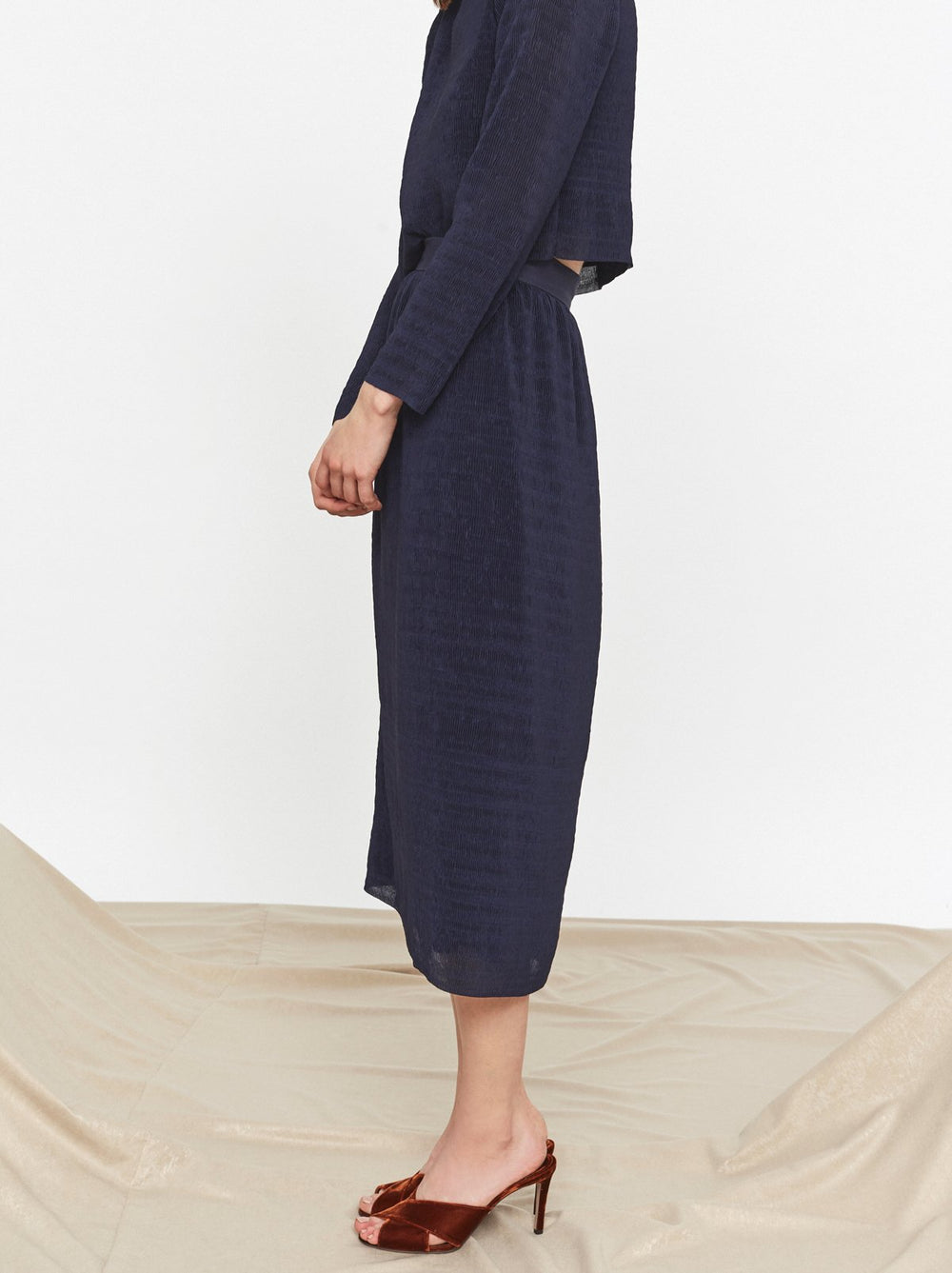 Connie Navy Plisse Midi Skirt by KITRI Studio