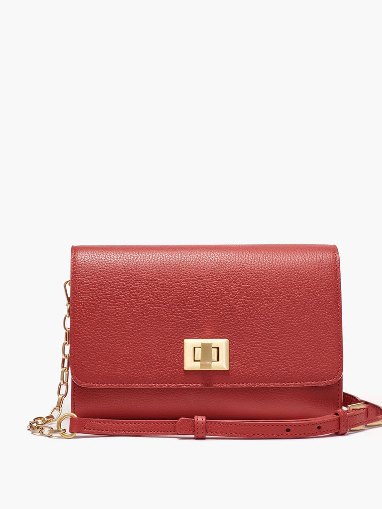 Meadow Crossbody Clutch with Turn Lock Closure, Adjustable Shoulder Strap, and Gold Finishes in Color Red