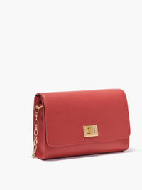 Side View if the Meadow Crossbody Clutch with Turn Lock Closure, Adjustable Shoulder Strap, and Gold Finishes in Color Red