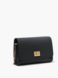 Side View if the Meadow Crossbody Clutch with Turn Lock Closure, Adjustable Shoulder Strap, and Gold Finishes in Color Black