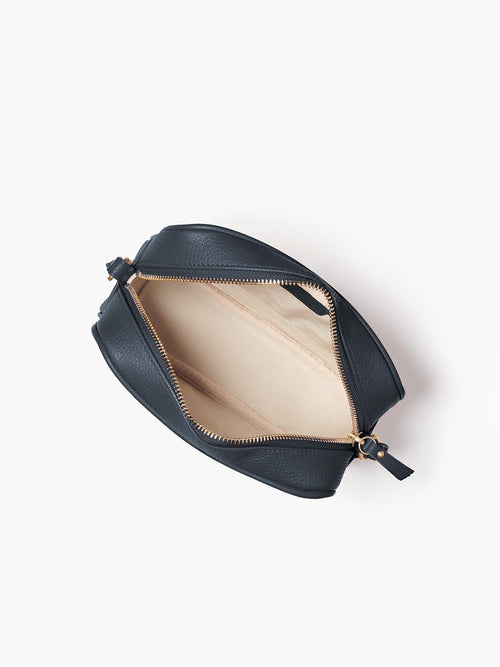 Hampton Crossbody Bag Open Top View of Fabric Interior, Zipper, and Gold Finishes in Color Navy Blue