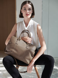 Hudson Satchel with Adjustable Shoulder Strap and Gold Finishes with Model in Color Taupe