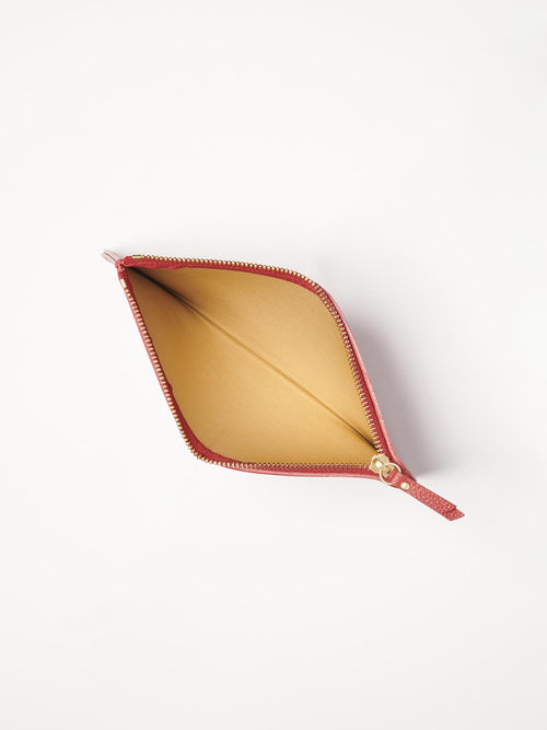 Top View of the Medium Leather Zip Case in Color Red with Gold Finishes; Interior Features Gold Saffiano Lining