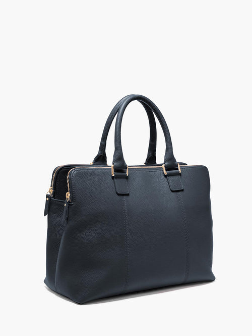 Hudson Satchel Side View of Zipper and Gold Finishes in Color Navy Blue