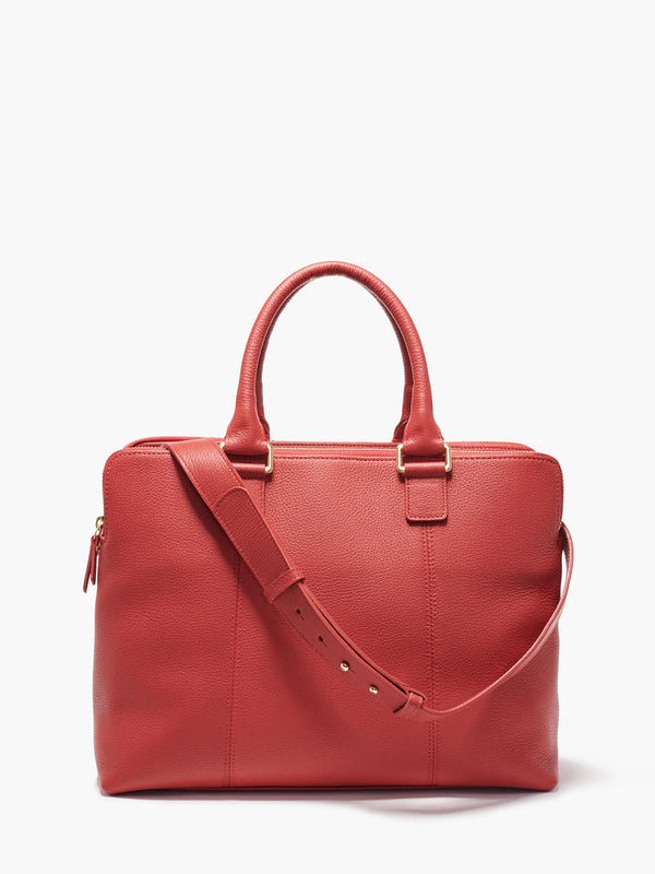 Hudson Satchel with Adjustable Shoulder Strap and Gold Finishes on Model in Color Red