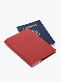 Front View of Leather Passport Cover in Color Red with Example Passport Book;