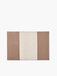 Open View of Leather Passport Cover in Color Taupe; Features a Faux Suede Interior and Two Leather Pockets