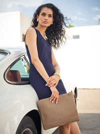 Model Holding the Leather Zip Case in Color Taupe with Zipper Closure and Gold Finishes