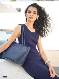 Bleecker Tote Bag in Color Navy Blue with Brushed Gold Hardware on Model for Size Comparison