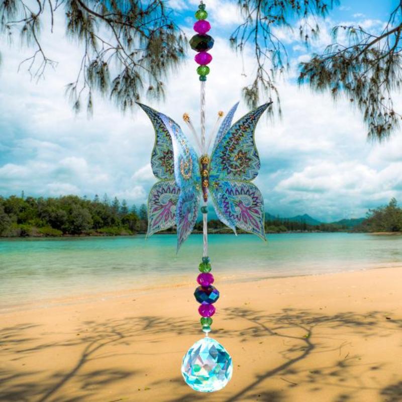 Hand made crystal suncatcher with an aquamarine butterfly motif. Made in Byron Bay, Australia.