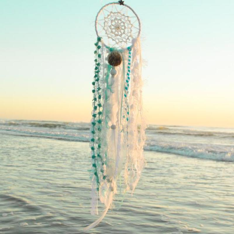 Handmade boho dream catcher by visionary artisan Kylee Joy in beautiful turquoise and white tones.
