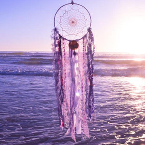 Handmade boho dream catcher by visionary artisan Kylee Joy in purple tones.