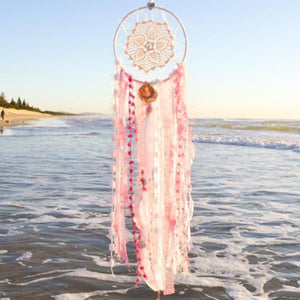Handmade boho dream catcher by visionary artisan Kylee Joy in beautiful pink and white tones.