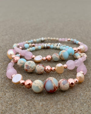 Intentional jewellery hand made in Byron Bay. Boho style natural crystal anklet featuring rose quartz, blue howlite, sea-sediment jasper, hematite, freshwater pearls and white alabaster beads strung on durable jewellers elastic.