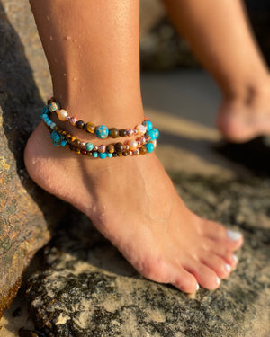 Intentional jewellery hand made in Byron Bay. Boho style natural crystal anklet featuring tiger eye, sea sediment jasper, hematite and freshwater pearl beads strung on durable jewellers elastic.