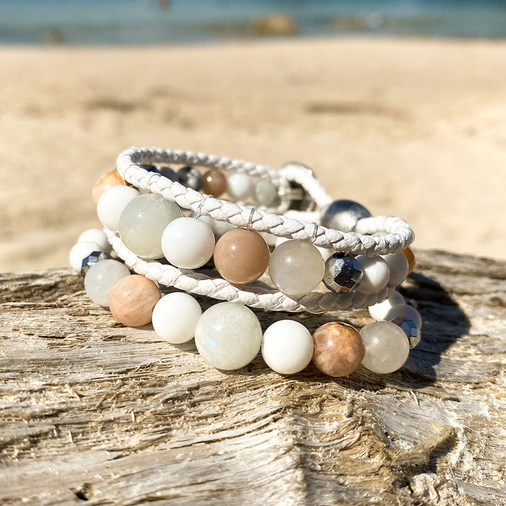 Artisan Crafted Natural Stone bracelet stack of two handmade in Byron Bay. Features natural White Alabaster, Howlite, natural sunstone, natural moonstone, freshwater pearl, Hematite, and Lava Stone beads.