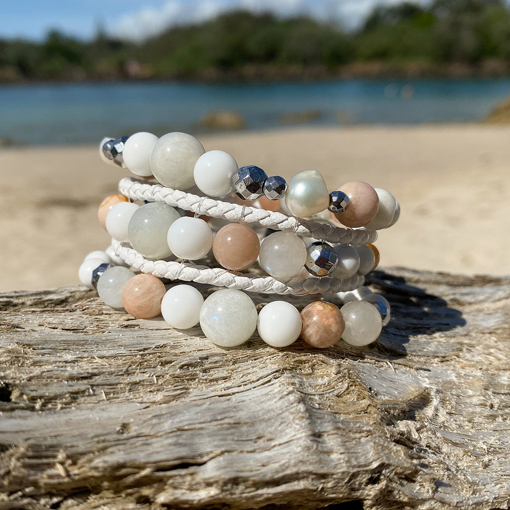Artisan Crafted Natural Stone bracelet stack of three handmade in Byron Bay. Features natural White Alabaster, Howlite, natural sunstone, natural moonstone, freshwater pearl, Hematite, and Lava Stone beads.