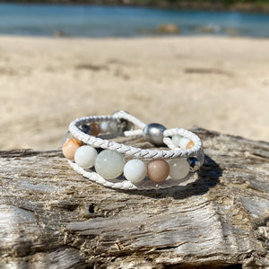Artisan Crafted Natural Stone leather wrap bracelet handmade in Byron Bay. Features natural White Alabaster, Howlite, natural sunstone, natural moonstone, freshwater pearl, Hematite, and Lava Stone beads.