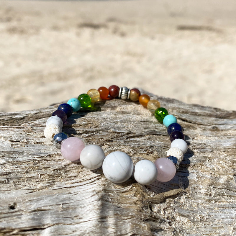 Artisan Crafted Natural Stone bracelet stack of three, handmade in Byron Bay. Features natural White Alabaster, Howlite, Rose Quartz, Amethyst, Peridot, Citrine, Carnelian, Red Coral, Hematite, and Lava Stone beads.