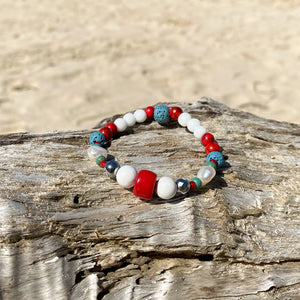 Artisan Crafted Natural Stone Leather Wrap bracelet handmade in Byron Bay. Features Natural white and Blue Howlite, Tridacna, African Turquoise, Red Coral and Lava Stone beads.