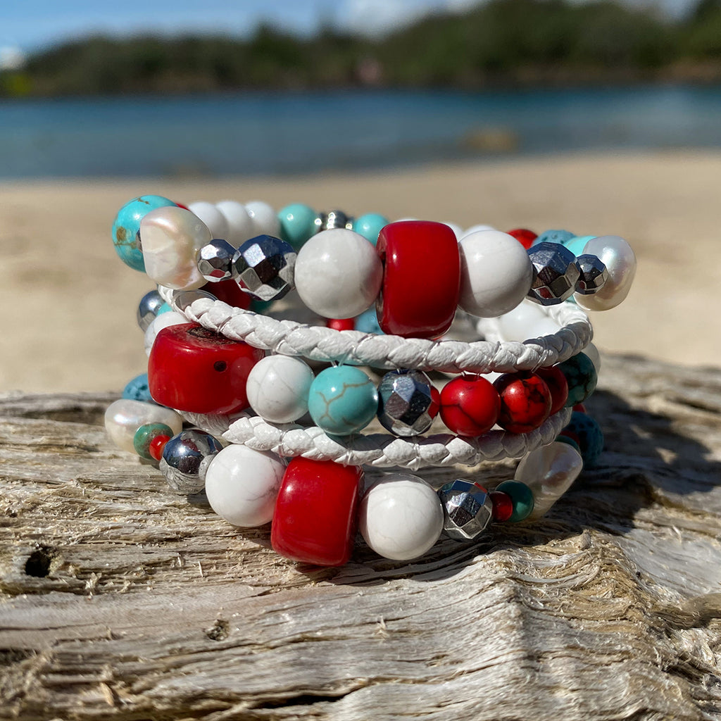 Artisan Crafted Natural Stone bracelet stack of three handmade in Byron Bay. Features Natural white and Blue Howlite, Tridacna, African Turquoise, Red Coral and Lava Stone beads.