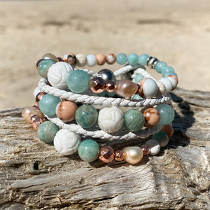 Stack of three artisan crafted natural crystal and lava stone beaded bracelet. Suitable for diffusing essential oils such as young living or Doterra. Handmade in Byron Bay. Great gift for  women. Features Ocean jasper & Amazonite crystals and freshwater pearls.