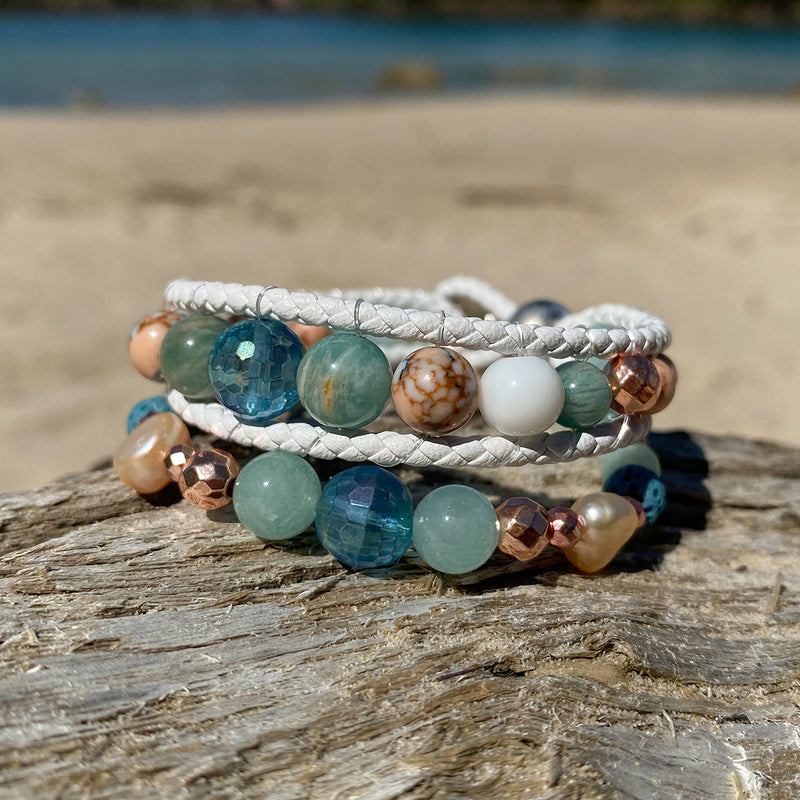 Stack of two artisan crafted natural crystal and lava stone beaded bracelet. Suitable for diffusing essential oils such as young living or Doterra. Handmade in Byron Bay. Great gift for  women. Features Ocean jasper & Amazonite crystals and freshwater pearls.