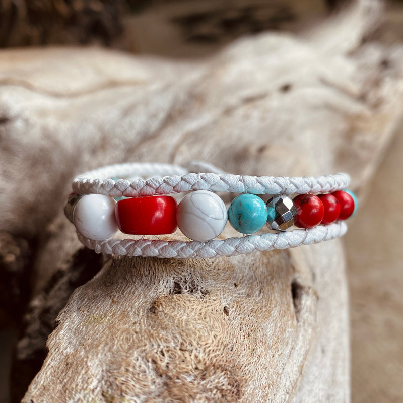 Artisan Crafted Natural Stone bracelet stack of two handmade in Byron Bay. Features Natural white and Blue Howlite, Tridacna, African Turquoise, Red Coral and Lava Stone beads.