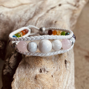 Artisan Crafted Natural Stone leather wrap bracelet handmade in Byron Bay. Features natural White Alabaster, Howlite, Rose Quartz, Amethyst, Peridot, Citrine, Carnelian, Red Coral, Hematite, and Lava Stone beads.