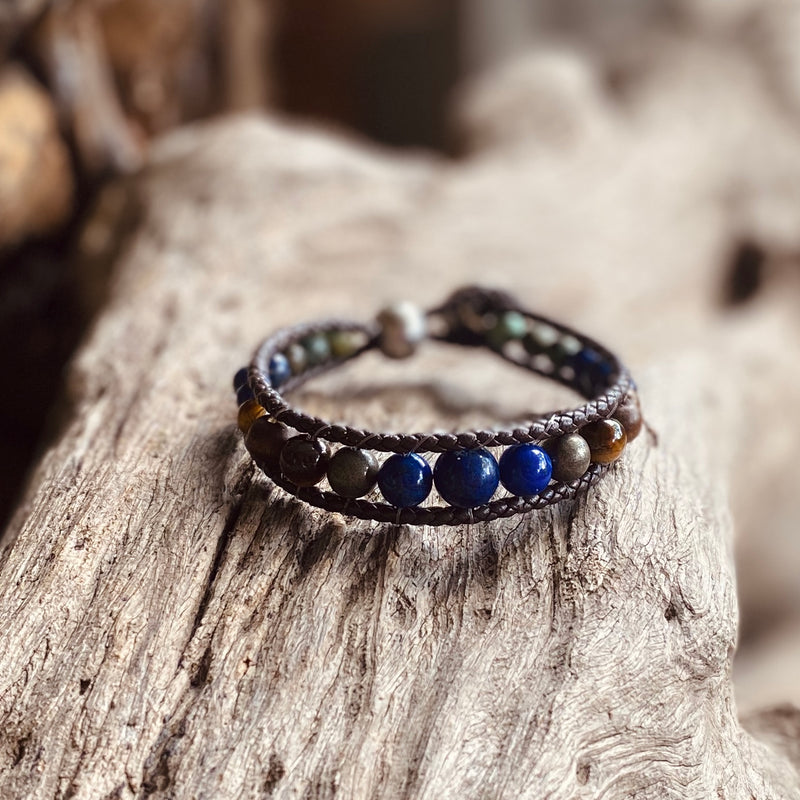 Artisan Crafted Natural Stone Leather Wrap bracelet handmade in Byron Bay. Features Natural Lapis Lazuli, Tiger Eye, African Turquoise, Pyrite and Lava Stone beads.