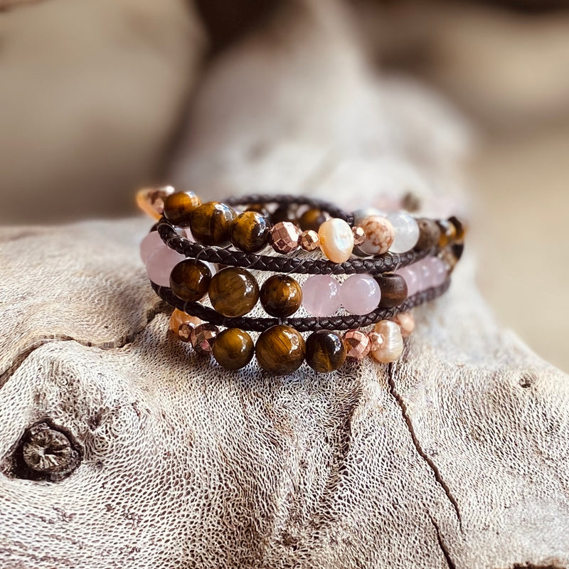 Artisan Crafted Natural Stone bracelet stack of three, handmade in Byron Bay. Features natural Tiger Eye, Rose Quartz, Freshwater Pearl, Hematite, and Lava Stone beads.