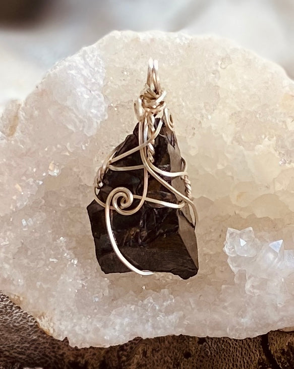 Artisan crafted natural Elite Shungite pendant necklace handmade in Byron Bay. Wrapped in eco-friendly, recycled 925 sterling silver wire.