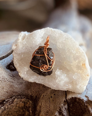 Artisan crafted natural Elite Shungite pendant necklace handmade in Byron Bay. Wrapped in non-tarnish Copper wire.