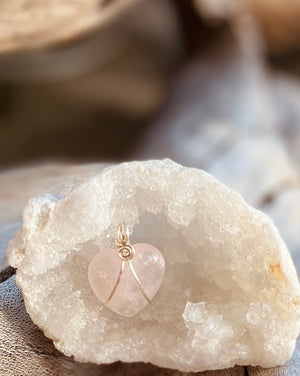 Artisan crafted natural Rose Quartz crystal heart shaped pendant necklace handmade in Byron Bay. Wrapped in Eco friendly 925 sterling silver.