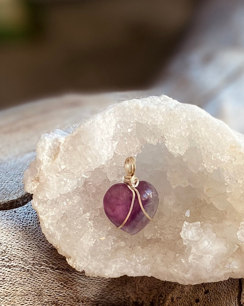 Artisan crafted natural Rainbow Flourite crystal heart shaped pendant necklace handmade in Byron Bay. Wrapped in Eco friendly 925 sterling silver.