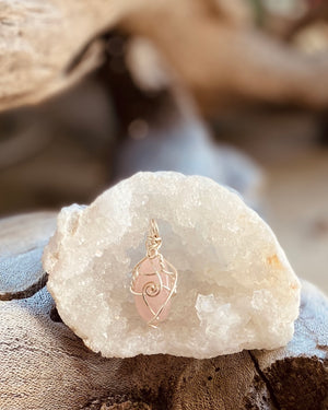 Artisan crafted natural Rose Quartz crystal pendant necklace, handmade in Byron Bay. Wrapped in fine silver-plated copper wire.