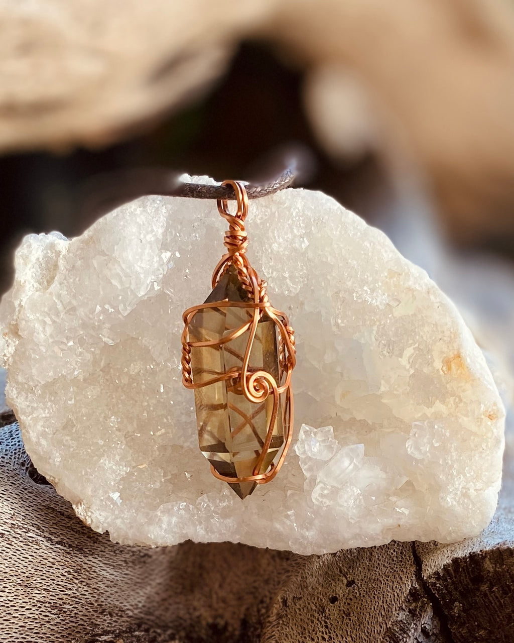 Artisan crafted natural double terminated Smokey Citrine pendant necklace, handmade in Byron Bay. Wrapped in pure, non-tarnish copper wire.