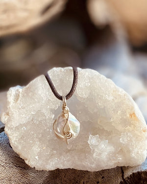 Artisan crafted natural Freshwater Pearl pendant necklace handmade in Byron Bay. Wrapped in Eco friendly 925 sterling silver.